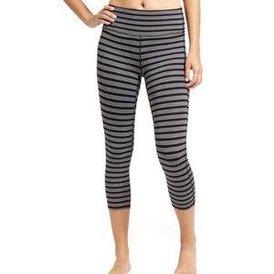 Athleta black & grey striped chaturanga leggings